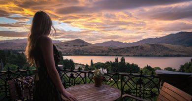 woman enjoys beautiful balcony view