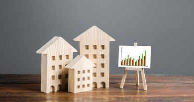 Residential buildings and easel with a positive growth trend chart.