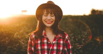 happy woman red plaid shirt