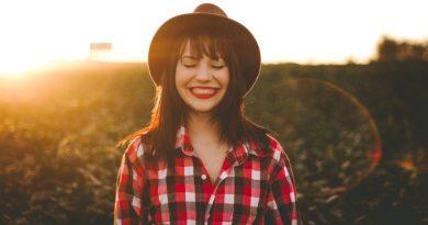happy woman red plaid shirt