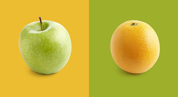 Apple and orange against yellow and green background