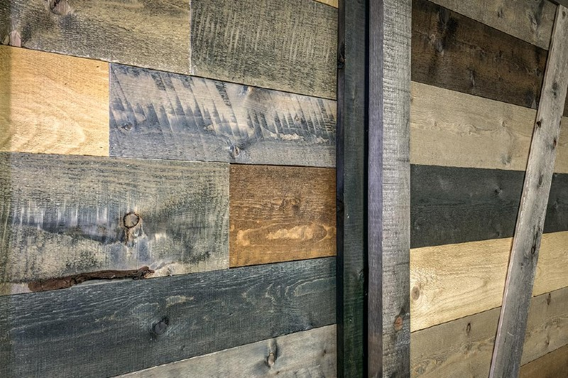 accent-wall-in-a-box-closeup-with-barn-door-in-a-bo