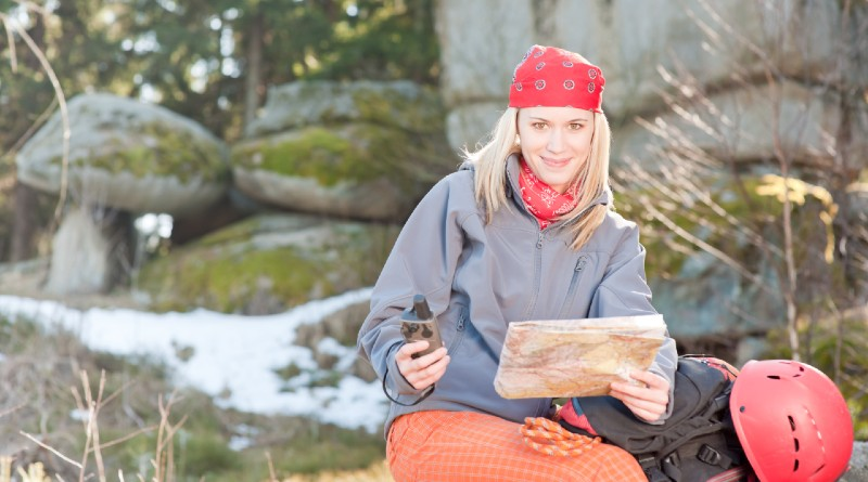 adventurous-young-woman-uses-technology-to-stay-safe-and-navigate