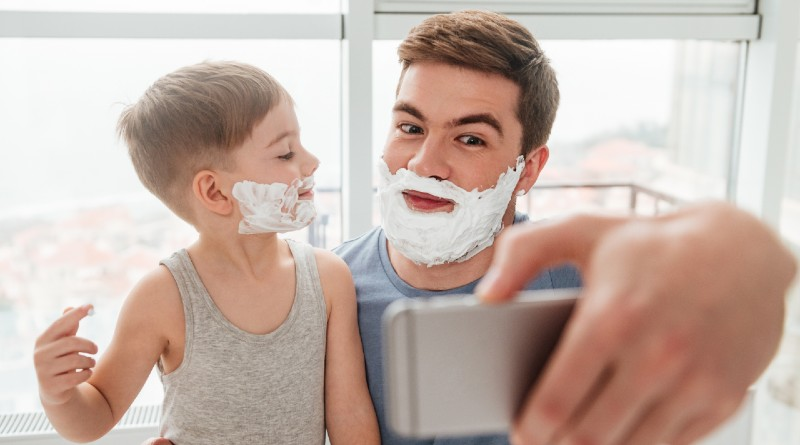 little-boy-and-father-have-fun-playing-shave-together-smiling-while-taking-selfie
