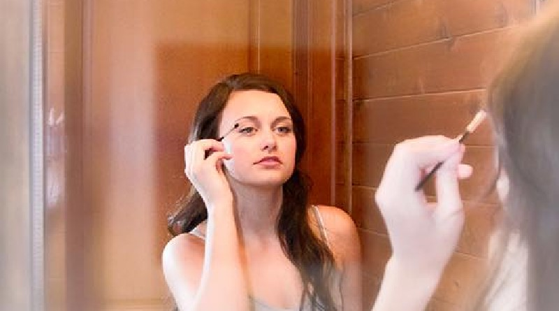 pretty-young-woman-puts-on-makeup-after-shower-in-fog-free-mirror