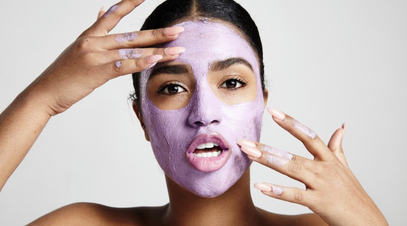 woman-applying-facial-mask