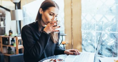 young-woman-sitting-in-coffee-shop-using-technology-to-work-anywhere