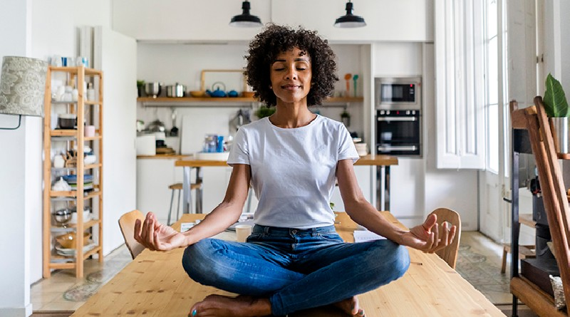 woman-meditates-relaxes-on-her-kitchen-table